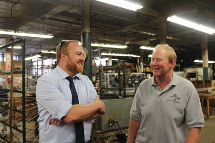 Sen. Libby and Rusty Vallee of Maine Thread Co. talk in the company's Lewiston facility